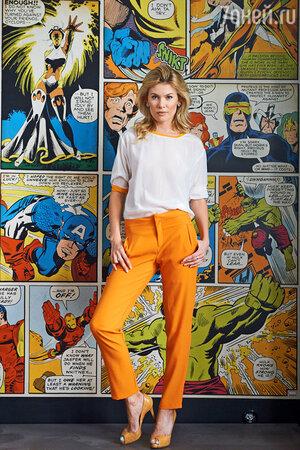 На Анне: Блуза и брюки Ecrin Archives, туфли Christian Louboutin