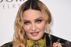 Мадонна вышла в свет с молодым любовником