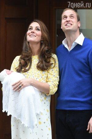 Принц Уильям и Кейт Миддлтон с дочерью