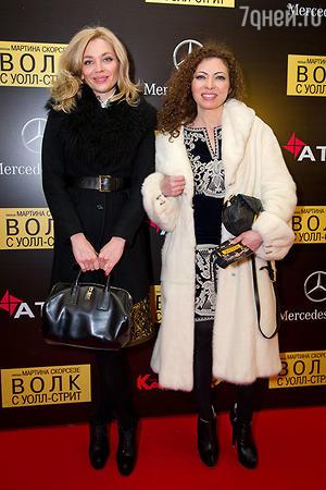 Татьяна Миловидова и Наталья Ибадин (группа «Банд'Эрос»)  на премьере фильма «Волк с Уолл-стрит»