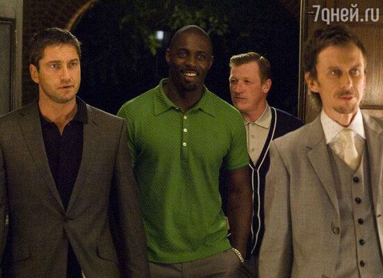 Кадр из фильма «Рок-н-рольщик» (2008)