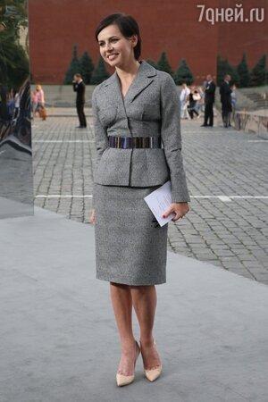 Оксана Лаврентьева на показе осенне-зимней коллекции 2013/2014 модного дома Dior на Красной площади в 2013 году