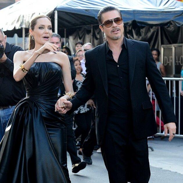 Анджелина Джоли и Брэд Питт на премьере фильма «Малефисента»