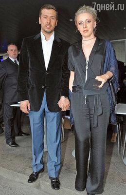 Андрей Мерзликин с супругой