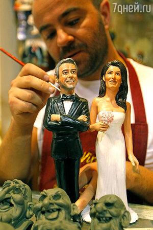 Статуэтки Джорджа Клуни и Амаль Аламуддин