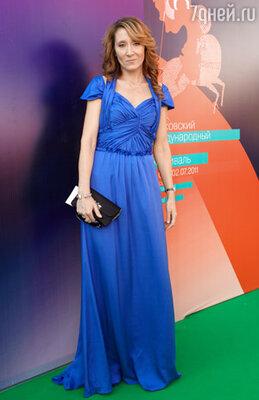 Юрате Гураускайте (платье Escada, клатч Dior)