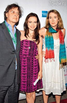 С отцом Эндрю и матерью Лесли