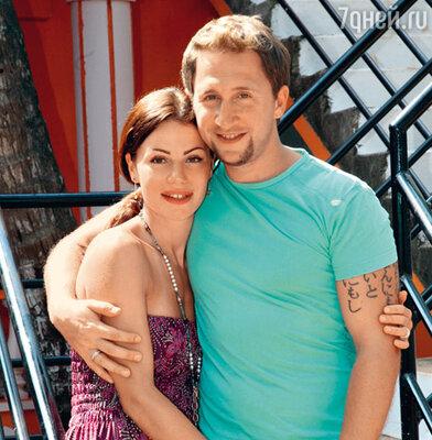 Оскар Кучера с женой Юлей