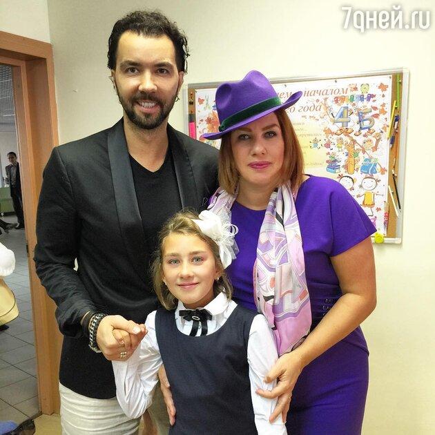 Денис Клявер и Ева Польна с дочерью Эвелин