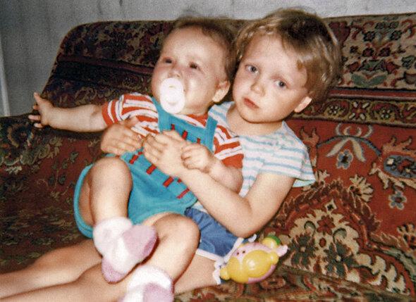 С братом Андреем. Он старше на четыре года
