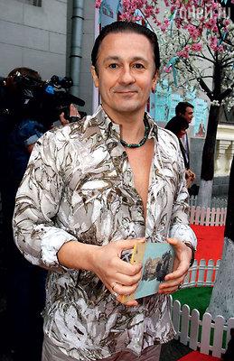 Олег Меньшиков на московском показе одного из известных французских кутюрье. 2010 год