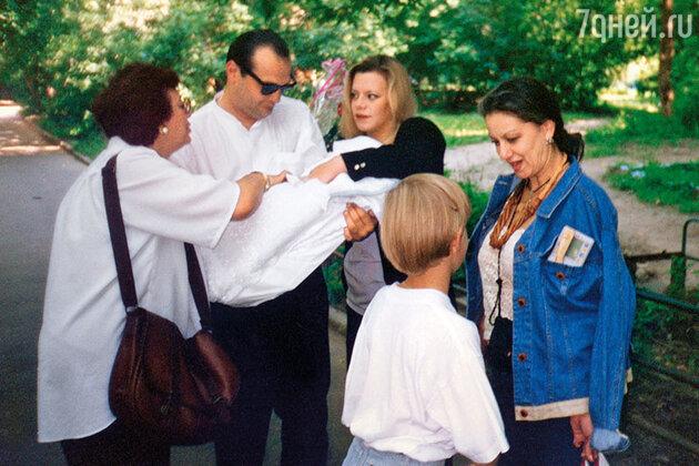 Яна Поплавская с семьей